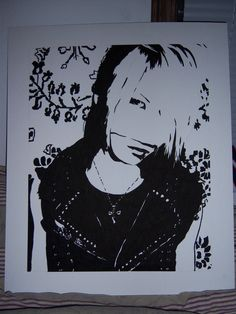 Black and White high contrast inked painting of Reita.  He's a bassist from the band 'Gazette'