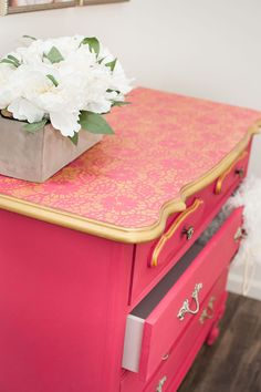 On trend: dresser with gold lace accents and bright pink mix of Chalk Paint® by Annie Sloan