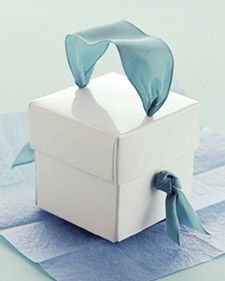Gift box idea from Martha...Just love the idea of adding an accessory to a gift! What a great idea for holidays or a birthdays!*