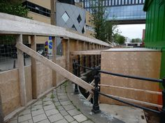 https://flic.kr/p/gFTewB   Urban composition: wooden building fences and bridge on Roeterstraat, over the canal water Nieuwe Achtergracht in Amsterdam; photography by Fons Heijnsbroek   Temporary urban composition of wooden building fences and the old bridge with on the background The Gate of the rebuild university building, view from Roeterstraat, over the canal water Nieuwe Achtergracht in Amsterdam; photography by Fons Heijnsbroek, 2013