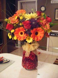 Flower arrangement fall theme _ cranberry filled vase