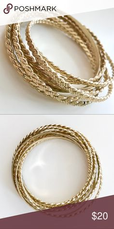 EXPRESS Gold Bangle Bracelets Set of pretty gold bangles from Express. No tags but these are unused. They're linked together and do not come apart.  **Pet/Smoke Free Home** **Questions Welcome**  **Price Is Firm On Items $13 & Under** Express Jewelry Bracelets