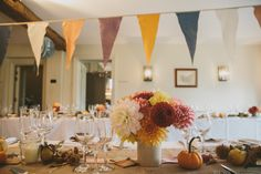 Autumnal Wedding Decor with Bunting & Dahlia Flowers - McKinley & Rodgers | The Olde Bell Hurley, Berkshire | Autumnal Styling | Tea Length Fur Coat No Knickers Wedding Dress | Story Catcher Videography