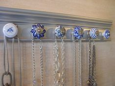 This wall rack has 6 blue ceramic knobs on s… necklace holder, jewelry organizer.This wall rack has 6 blue ceramic knobs on silver background long. Great gift of jewelry storage Diy Jewelry Unique, Diy Jewelry To Sell, Diy Jewelry Holder, Jewelry Organizer Wall, Rustic Jewelry, Jewellery Storage, Jewelry Organization, Jewellery Display, Handmade Jewelry