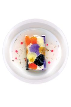 Shellfish and seaweed cream in a daikon-radish wrapper decorated with pansies - Chef Miguel Sanchez Romero, neurosurgeon turned chef.