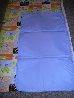 There are a lot of free patterns out there for diaper changing pads. I recently saw one made from a placemat, but it was too small for my t. Sewing Baby Clothes, Baby Sewing, Diaper Changing Pad, Wipes Case, Baby Crafts, Sewing For Kids, Placemat, Baby Bibs, Sewing Projects
