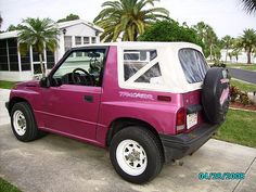 GEO TRACKER - I want one so bad. Prolly not in pink but great mpg and the top comes off for summer.