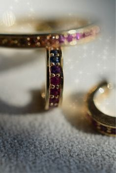 Crafted from 14K yellow gold, the handmade Pavé hoops are set with twenty-two delicate multi-coloured sapphires.