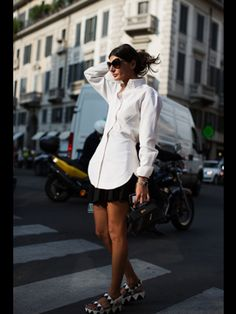 Like the idea of a larger/longer, tailored, crisp white shirt. Via thesartorialist.