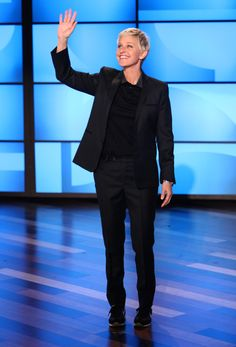Ellen's Look of the Day: Lanvin polo shirt; Nike sneakers; black suit.