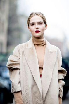 Trench over high neck sweater with a low ponytail
