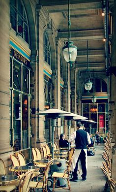 Le Nemours - Paris, France. French waiters have been wearing those traditional white apron since forever. Hidden in Paris by Corine Gantz. French novel reading list.