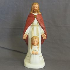 Vintage Girl's Catholic First Holy Communion Figurine. This small figurine commemorates an important milestone in Catholic life.  It features a
