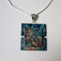 They sell this stuff on etsy. The mosaic is made from egg shells! Fused Glass Jewelry, Shell Jewelry, Wire Jewelry, Beaded Jewelry, Jewlery, Shell Pendant, Pendant Set, Eggshell Mosaic, Domino Art
