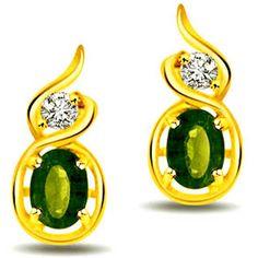 0.38 cts Diamond & Emerald Earrings    Oval emerald and diamonds combine to create a fine earring in 18k gold  Diamond Pcs: 2 pcs  Diamond Wt: 0.08 cts  Diamond Colour: I / J  Diamond Clarity: VS  Oval Emerald Pcs: 2 pcs  Oval Emerald Wt: 0.30 cts  Gold Wt: 2.500 gms  Gold Purity: 18kt  Dimension:H=1.00 CM