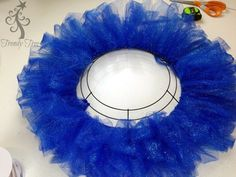 "Patriotic Wreath made with glitter tulle. Supplies MD005302 12"" Box Wire Wreath Form RC127724 Red Glitter Tulle - 2 rolls RC127734 White Iridescent Glitter"