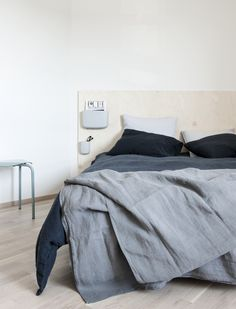Plywood headboard with Normann Copenhagen´s Pocket organizers (Finnish Design Shop) and Artek Lukki stool