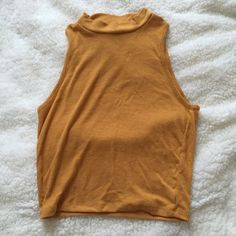 Mustard mock neck crop Worn once. Not from listed brand. Brandy Melville Tops Crop Tops