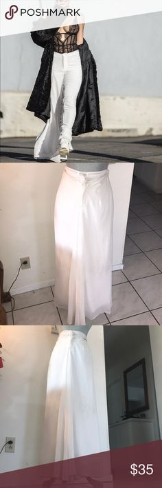 Boho chic double layered white trousers Is it a dress or are they pants? Keep them Guessing with this pair of over large trousers. They way flow brings elegance to any outfit. The Outer layer is chiffon and inner layer is silky polyester, your legs will love them. Nasty Gal Pants Trousers