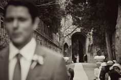 I love this composition with the groom in the foreground and the bride coming down the aisle behind.