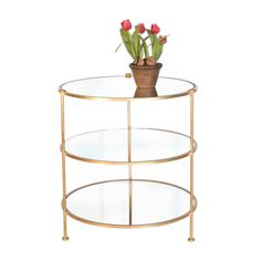 "3-Tier Gold leaf table w. mirrored shelves. COLOR: Gold, Mirror  DIMENSIONS: 28""H X 25""DIA"