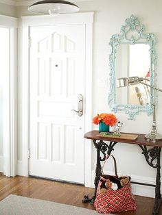 Even if your home doesn't have a formal foyer, you can make one with an end table and gorgeous mirror! It can be the perfect catchall space for your family: http://www.bhg.com/decorating/storage/organization-basics/slivers-of-space-storage/?socsrc=bhgpin013114entryway