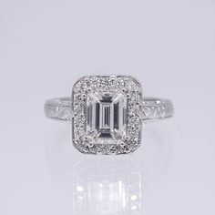 This ring highlights a GIA certified emerald shape diamond center stone in a white gold antique style halo setting. Emerald Diamond, Halo Diamond, Diamond Rings, Emerald Cut Engagement, Engagement Rings, Thing 1, Halo Setting, Custom Jewelry Design, Halo Rings