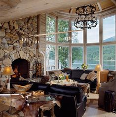 Love the stone work in the fireplace (pic via mountain log homes)