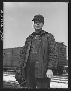 Argentine, near Kansas City, Kansas. Floyd C. McKillip, switchman, in the Atchison, Topeka and Santa Fe Railway yards. The paper stuck in his cap is a switch list 1943 Railroad History, Choo Choo Train, Old Images, Train Tracks, Conductors, Best Memories, My Father, Santa Fe, Kansas City