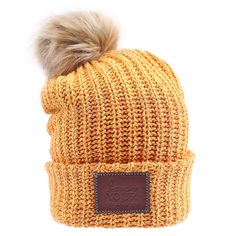 67f142d443e This pom beanie is knit from cotton yarn in honey yellow and orange colors.  It features a brown leather patch debossed with the Love Your Melon logo  and a ...