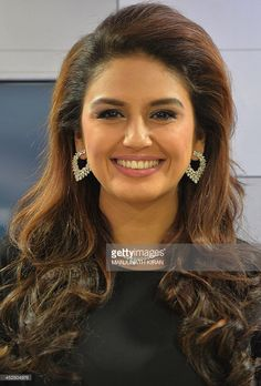 Indian Bollywood actress Huma Qureshi poses during the launch of the...