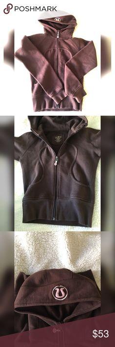 Lululemon scooba hoodie size 4 Size 4 Lululemon scuba full zip hoodie. Very warm and no flaws at all. Pretty dark town color with pink lulu sign on hood lululemon athletica Tops Sweatshirts & Hoodies
