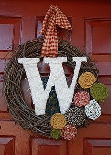 front door. super easy to make with fabric rosettes!