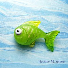 Green Guppy by Heather Sellers.  Inspiration from Claudia Trimbur-Pagel's book Fish Recipes.  #lampwork #glass #bead #fish