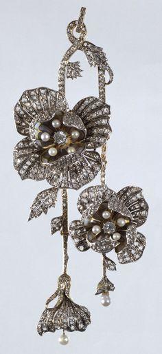 An Art Nouveau gold, silver, enamel, diamond and pearl pendant, by Lluis Masriera, Barcelona, circa 1904. 12.6 x 5.1cm. #Masriera #ArtNouveau #pendant