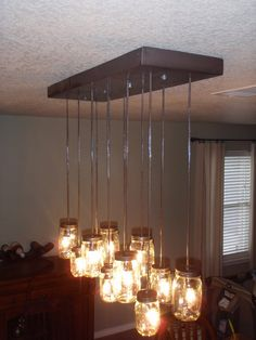 Next house project, Mason Jar Chandelier...Brad figured out how to do it, so we don't spend $400 at Pottery Barn.