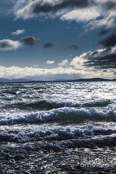 Turbulent scenes in dramatic clarity of waves crashing and splashing on a clouded Tasmanian ocean shore. Shallows and depths of Adventure Bay, Bruny Island, Tasmania, Australia by Ryan Jorgensen