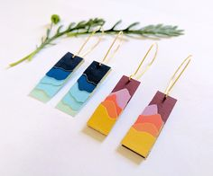 This instructable shows you how to make a pair of lovely layered landscape earrings from paper! They're simple to make, but still elegant with a touch of gold on the sides. Each layer of the abstract landscape silhouette is subtly separated to give some depth. The two designs pictured above show ocean waves and a mountain scene, but feel free to get creative and design your own.