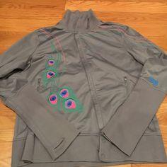 Reebok women's workout jacket Gorgeous grey women's reebok workout jacket. Asymmetrical zipper, snap collar, thumb holes, designer collaboration with maya hayuk. Reebok Jackets & Coats