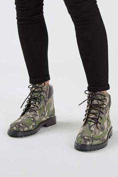 Master the hiker-look without the hard work! These tomboy-style boots come in a camo suede leather finish and feature detailed laces. #Topshop