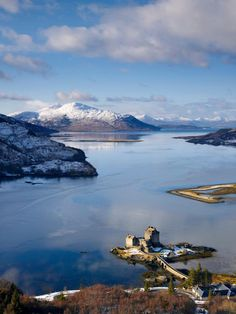 View of Eilean Donan Castle on the Loch Duich and Loch Alsh to the Isle of Skye on a clear winter day.