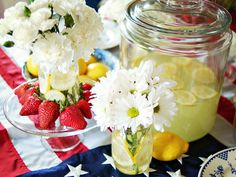 Make it easy for guests to help themselves to a refreshing refill by placing a large glass canister filled with lemonade on the table to add color and act as part of the centerpiece. Scatter fresh lemons around the table to add cheery pops of yellow and a clean citrus fragrance.
