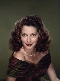 Love how well the palette of her dress compliments her hair. Ava Gardner