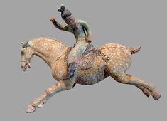 A ceramic female polo player, from northern China, Tang Dynasty, first half of the 8th century, made with white slip and polychrome. From the Musée Guimet (Guimet Museum), Paris. Wu Zetian, Chinese Figurines, Art Chinois, Art Asiatique, Art Premier, Animal Bones, Terracota, Horse Sculpture, China Art