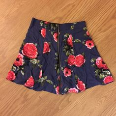 NWOT  Floral Mini Skirt *pardon the wrinkles* this cute Urban Outfitters front zip floral skirt has never been worn. Size small but fits more like an XS. very soft & twirly, with 2 pockets! feel free to make an offer  Urban Outfitters Skirts Mini