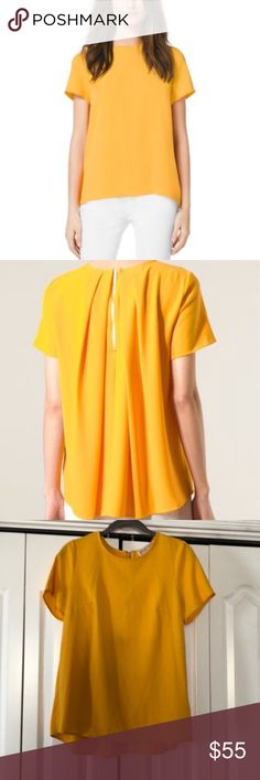 Michael Kors Pleated-Back Crepe Top Michael Kors pleated back crepe top in taxi yellow. Worn a handful of times but is pretty much brand new.  This color is amazing and looks awesome with a light wash denim shorts or white denim and shorts! The back is amazing to! Michael Kors Tops Blouses
