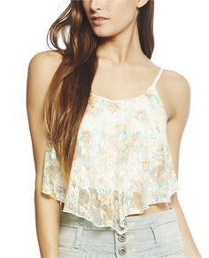 """Cute little tank can be rocked from any festival to the beach with its sweet floral printed lace, swing hanky construction, spaghetti straps, double scoop neck, and asymmetrical hemline. Tank is semi-lined.  Model is 5'9"""" and wears a size small   Self: 95% Nylon / 5% Spandex - Lining: 100% Polyester Hand Wash Imported"""