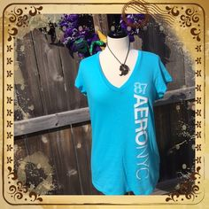 """NWOT Aeropostale Top Size XL NWOT Aeropostale Top, Size is XL. Plastic hang tag is on it, but price tag is not. Turquoise color with White Lettering. Measurements laying flat: Shoulders 17.5"""", Chest 19"""", Length 25"""". Mannequin is a 36-24-36 to give you an idea of fit. 100% Cotton. Machine Wash Cold. No Trades, PayPal or Low Ball Offers Aeropostale Tops"""