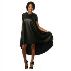 Black Faux leather high-low dress. Short sleeves. Scoopneck collar.   Can be paired with black leather over-the-knee boots