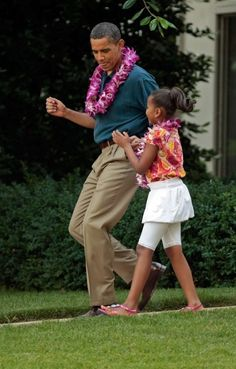 President Barack Obama With Daughter Sasha Obama....